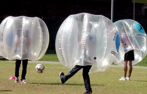 Image of kids playing with Emerald Events bubble bumper soccer equipment