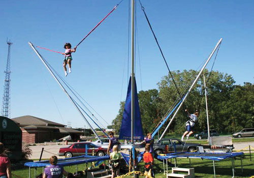 A little girl using a Bungee Jumping Rental