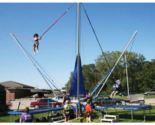 Image of a girl using a kids bungee jumping rental