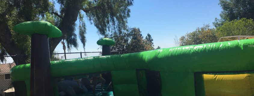 Image of kids playing in the jungle obstacle course at Arroyo School Carnival