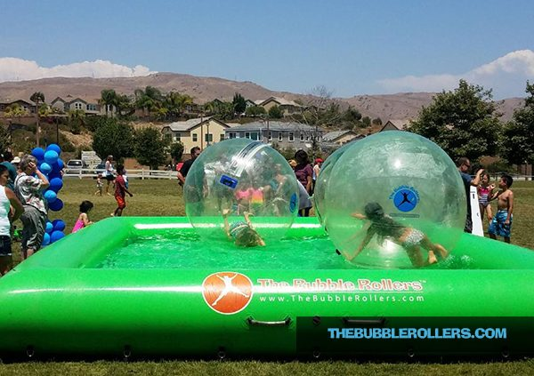 Kids playing in Bubble Rollers in the City of Corona