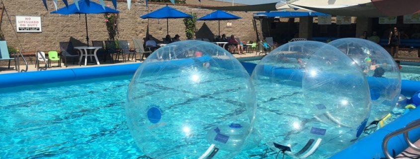 Bubble Rollers floating in Blue Buoy Swim School Pool