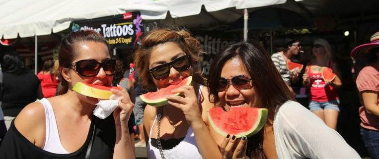 Girls eating watermelon at the California Watermelon Festival