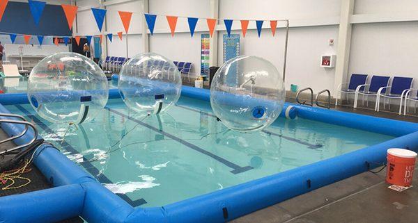 3 Bubble Rollers floating in Water Safe Swim School Pool