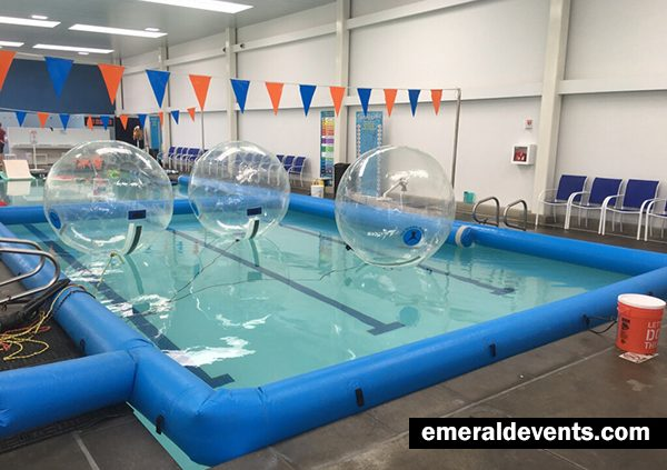 3 Bubble Rollers floating in Water Safe Swim School Pool