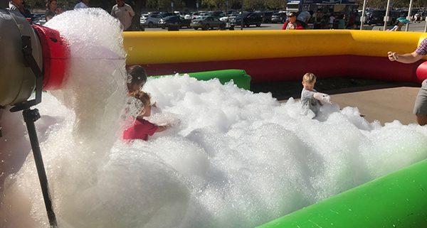 Rose Bowl Aquatics Center in Pasadena enjoys a foam party rental provided by Emerald Events. Rose Bowl Aquatics Rents foam party rental