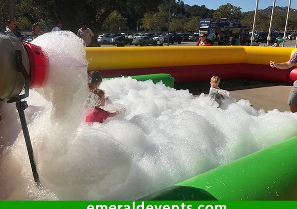 Rose Bowl Aquatics Center in Pasadena enjoys a foam party rental provided by Emerald Events. Rose Bowl Aquatics Rents foam party rental