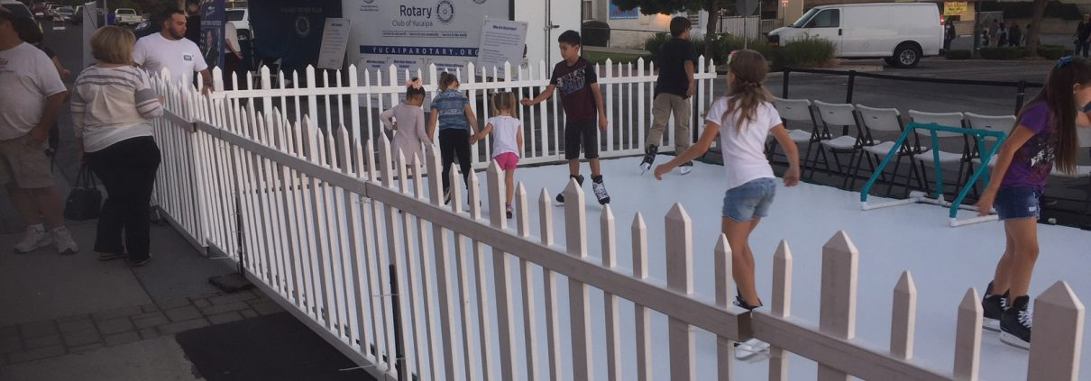 Kids using a synthetic ice skating rink