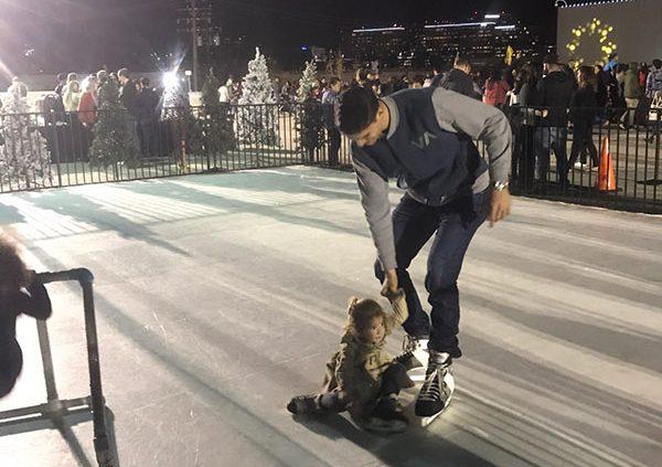 families skating on a fake ice skating rink rental