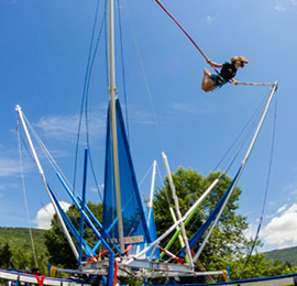 Lady using a bungee jump rental in southern california. Emerald Events remnts bungee jumpers and trampolines.