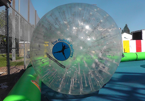 large land roller zorb balls used for large events, school carnivals, team building. Available for rent in Southern California at Emerald Events AKA The Bubble Rollers